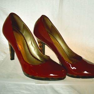 Jessica Simpson red pumps